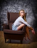 Portrait of young woman on chair