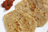 picture of ghee  - A paratha (or parantha) is a flatbread that originated in South Asia. It is made with whole-wheat flour pan fried in ghee or cooking oil and sometimes stuffed with vegetables. ** Note: Soft Focus at 100%, best at smaller sizes - JPG