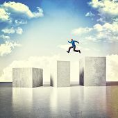 3d image of huge concrete block and jumping man