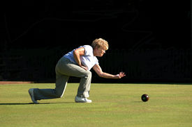 pic of crown green bowls  - A woman bowling. ** Note: Slight graininess, best at smaller sizes - JPG