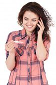 Beautiful girl with pregnancy test talking on cell phone on white background