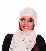 Young woman posing with cap and scarf on the white background