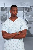 stock photo of hospital gown  - Black African American man patient in a hospital gown - JPG