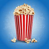 Striped carton bowl filled of popcorn