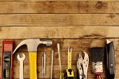Closeup of assorted work tools on wood