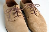 Brown Suede Leather Shoes On White