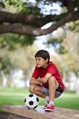 Boy in the park with soccer ball
