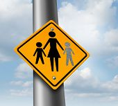 image of child missing  - Lost child or missing kid concept with a mother and children icon on a traffic sign with an empty paint spot as a symbol of parents losing their children in a failed adoption or despair - JPG