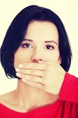 Teen woman covering mouth with hand , isolated