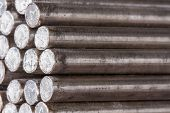 Stack Of Round Steel Bar - Iron Metal Rail Lines Material.