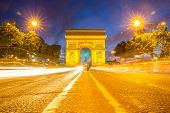 Arc of Triomphe Champs Elysees Paris city at sunset