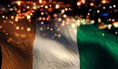 Cote D'ivoire National Flag Light Night Bokeh Abstract Background