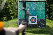 foto of archer  - Archer holds his bow aiming at a target - JPG