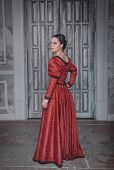 Beautiful Woman In Red Medieval Dress