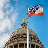stock photo of civil war flags  - Mississippi state flag flying in front of capitol building in Jackson - JPG