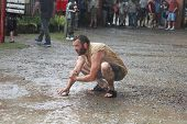 MUSKOGEE, OK - MAY 24: Grown men enjoy water and mud after rain at the Oklahoma 19th annual Renaissa