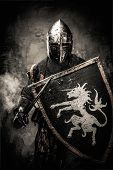 stock photo of knights  - Medieval knight against stone wall - JPG