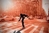 Ballet partners dancing gracefully together against new york street