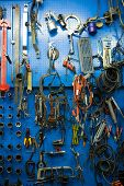 Blue storage wall for tools at the repair garage
