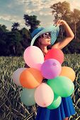 The girl with balloons. Vintage style