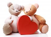Teddy Bears with red heart isolated on white
