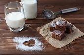 foto of brownie  - chocolate brownie with milk and supar powered heart - JPG