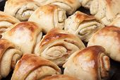 Buns From Yeast Dough With Cinnamon And Poppy Twisted Shell.