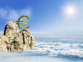 Euro Sign On A Mountain Top Among The Clouds, Concept