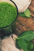 Spinach drink on a wooden table