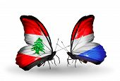 Two Butterflies With Flags On Wings As Symbol Of Relations Lebanon And Luxembourg