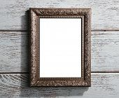 Vintage photo frame on color wooden background