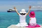 Two Girls Tourist Turquoise Sea Goodbye Hand Gesture poster