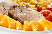 Roast pork, boiled potatoes and vegetable salad