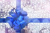 Gift with blue bow and holiday ribbon