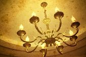 Vintage chandelier hanging under a ceiling in home