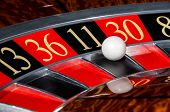 Постер, плакат: Classic Casino Roulette Wheel With Black Sector Eleven 11