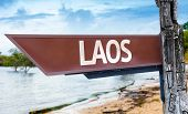 Laos wooden sign with a lake background