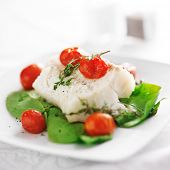 halibut on spinach on white plate