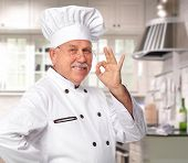 Mature professional chef man in modern restaurant