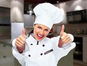 Young professional chef woman in modern kitchen