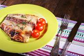 image of pangasius  - Dish of Pangasius fillet with rosemary and cherry tomatoes in plate on wooden table background - JPG