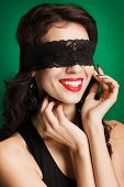 Beautiful brunette with dark blindfold.