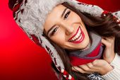 Winter portrait of a beautiful girl in the hat.