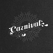 vector typographical illustration with ornate word carnival and light rays on the black cardboard te