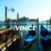 vector illustration of gondolas in Venice lagoon, Italy. Blurred cityscape with typographic label