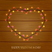 Heart From Light On Wooden Background