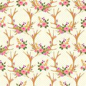 Vintage seamless pattern with deer antlers and flowers.