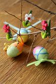 Easter decor eggs on wooden background - symbols of holiday