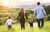 foto of father child  - Happy young family spending time together outside in green nature - JPG