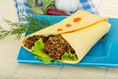 picture of shawarma  - Shawarma with meat salad leaves and spices